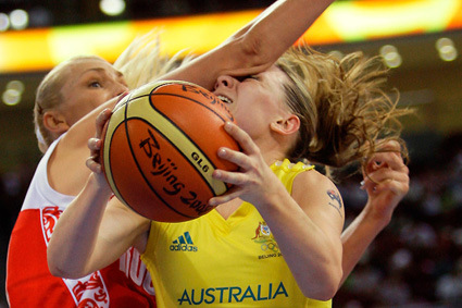 Australia's Penny Taylor, right, is fouled by Russia's Maria Stepanova during their women's basketball preliminary game at the Beijing 2008 Olympics in Beijing, Sunday, Aug, 17, 2008. (AP Photo/Dusan Vranic)